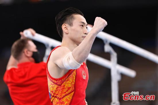 Chinese gymnast Zou Jingyuan wins men's parallel bars at Tokyo Olympics