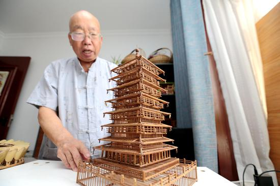 Senior craftsman records local history with bamboo models