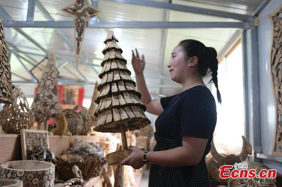 Former teacher reaps bonanza in wooden craft