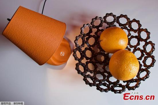Milan designers create 3D-printed lamp made out of orange peels
