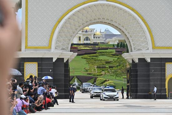 A convoy carrying Malaysian Prime Minister Muhyiddin Yassin leaves the National Palace in Kuala Lumpur, Malaysia, Aug. 16, 2021. (Photo by Chong Voon Chung/Xinhua)