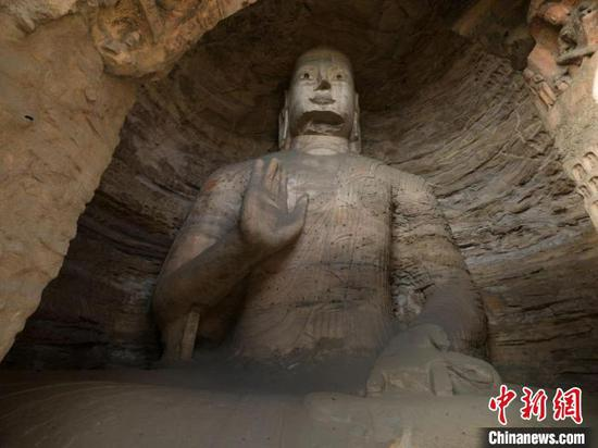 Yungang Grottoes opens No. 19 cave with statues of Buddha, son