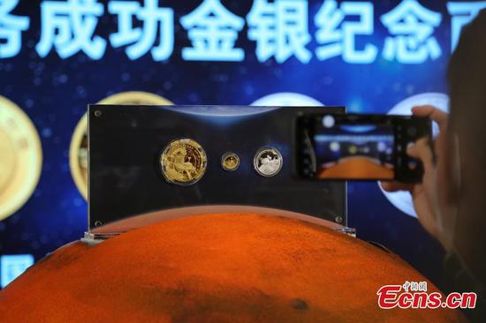 China issues commemorative coins to celebrate first Mars mission
