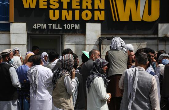 Main money exchange market reopens in Kabul, crowds remain outside banks: source