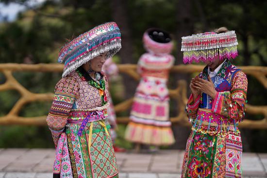 Miao people perform local dance in Yunnan
