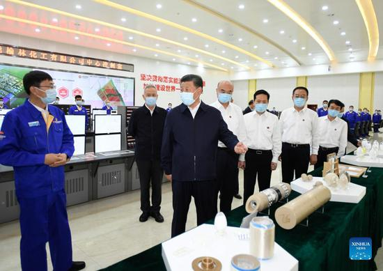 Chinese President Xi Jinping, also general secretary of the Communist Party of China Central Committee and chairman of the Central Military Commission, learns about the progress in making comprehensive use of coal amid circular economy at a chemical company during his inspection tour of Yulin City, northwest China's Shaanxi Province, Sept. 13, 2021. (Xinhua/Li Xueren)