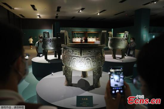 Large bronze tripods on display at National Museum of China
