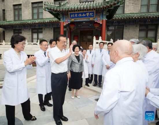 Chinese Premier Li Keqiang, also a member of the Standing Committee of the Political Bureau of the Communist Party of China (CPC) Central Committee, visits elderly experts and expresses his appreciation for their lasting dedication and remarkable achievements to the cause of healthcare during his inspection to Peking Union Medical College Hospital (PUMCH) in Beijing, capital of China, Sept. 13, 2021. Li convened a seminar with medical experts and listened to their advice on the development and innovation of the healthcare sector. (Xinhua/Wang Ye)