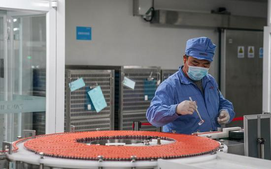 A staff member of Sinovac works on the COVID-19 vaccine production line in Beijing, July 8, 2021. (Photo/Xinhua)