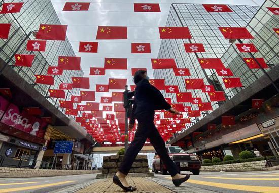 HK's role unique in assisting national development