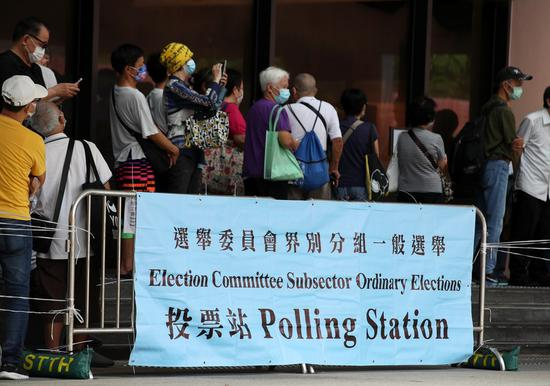 Hong Kong holds first election under improved electoral system