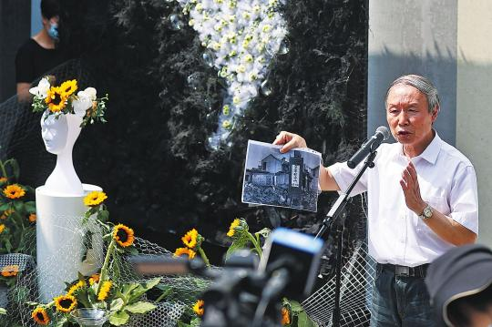 Su Zhiliang, a professor at Shanghai Normal University, displays evidence at an exhibition on Saturday in Nanjing, Jiangsu province, of the monstrous crimes of forced recruitment of