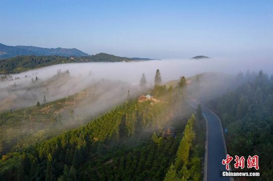 Village covered in fog in Guizhou, creates picturesque views