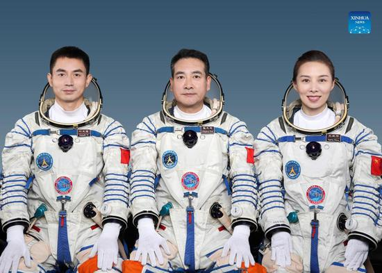 Chinese astronauts Zhai Zhigang (C), Wang Yaping (R) and Ye Guangfu will carry out the Shenzhou-13 spaceflight mission, and Zhai will be the commander, announced the China Manned Space Agency at a press conference on Oct. 14, 2021. (Xinhua)