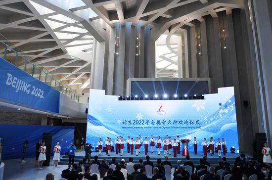 Beijing welcomes Olympic flame, unveils torch relay plan