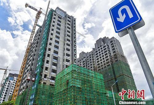 资料图:商品住宅建设工地  中新社记者 骆云飞 摄