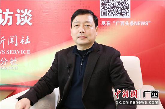 1月29日,广西住房城乡建设厅党组成员、副厅长杨绿峰接受中新社专访。中新社记者 林浩 摄