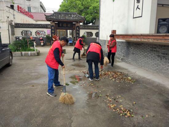 乾西乡志愿者开展文明创建。婺城提供