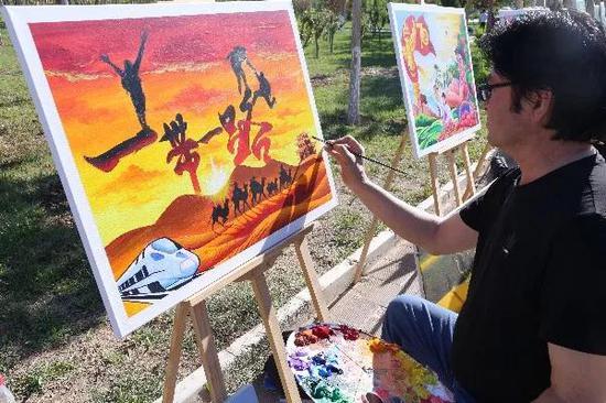 书画古城农民画展览。