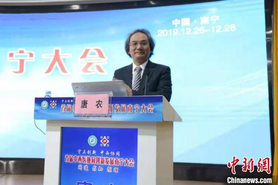 图为广西中医药大学校长唐农发言 林浩 摄