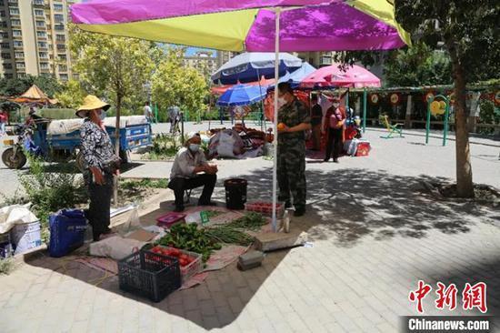新疆兵团做好居民保障供应 助力疫情防控(图)