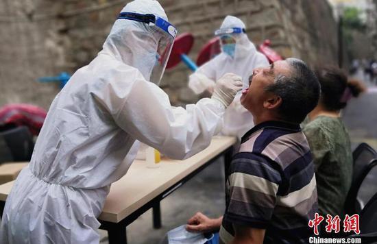 ?乌鲁木齐进入疫情防控战时状态:全面开展核酸检测