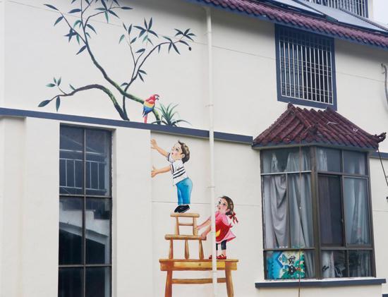 村内的彩绘墙 柯城区委宣传部提供