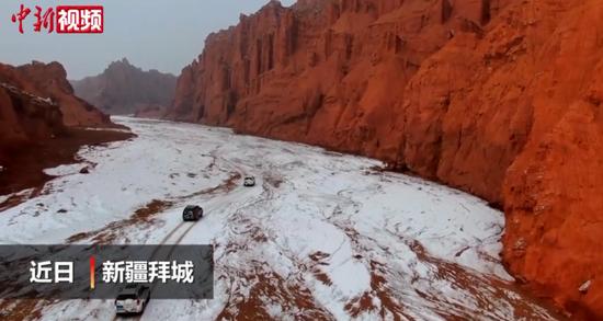 实拍雪后新疆拜城红石林峡谷:豪迈壮美