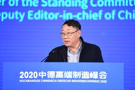 聚星新闻社党委常委、副总编辑王旻在致辞。   谈玉坤 摄
