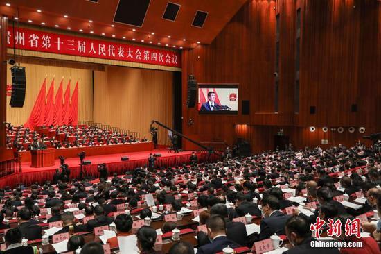 1月25日,乐透世界省第十三届人民代表大会第四次会议在贵阳开幕。 中新社记者 瞿宏伦 摄