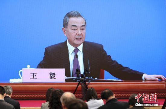 """王毅:所谓新疆地区存在""""种族灭绝""""的说法荒谬绝伦"""