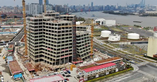 Building complex designed by Kazuyo Sejima capped