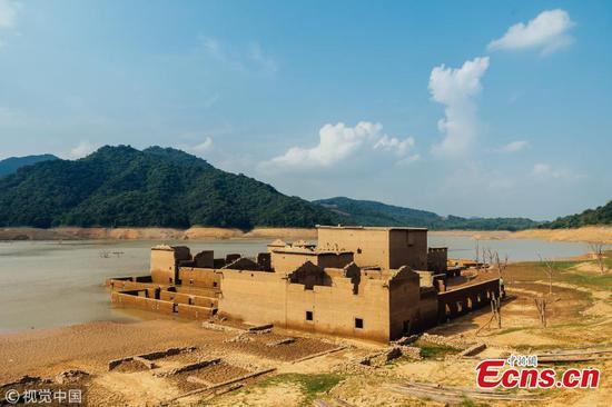 Village ruins rise from reservoir after 26 years